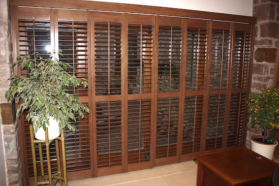 Stained Wood Plantation Shutters In a Barn Conversion