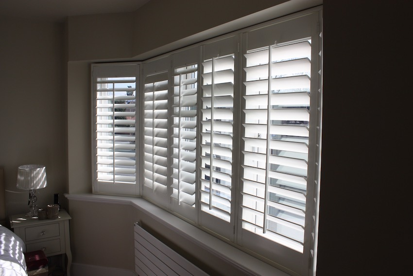 Bedroom With Bay window fitted with  Plantation Shutters
