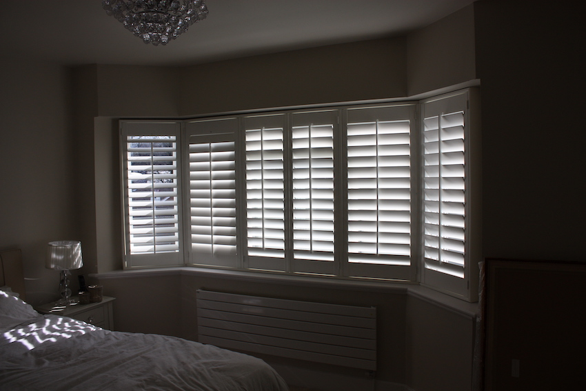 Bedroom Bay Window Fitted With Plantation Shutters