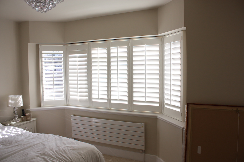 Shutters in bedroom bay