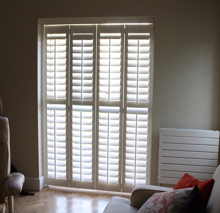 Small tracked  Plantation Shutters System In A Doorway