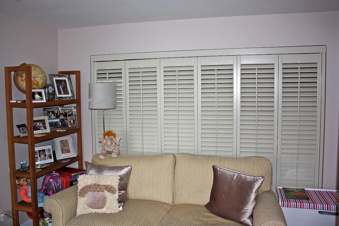Tracked Shutters Being Used As Room Dividers