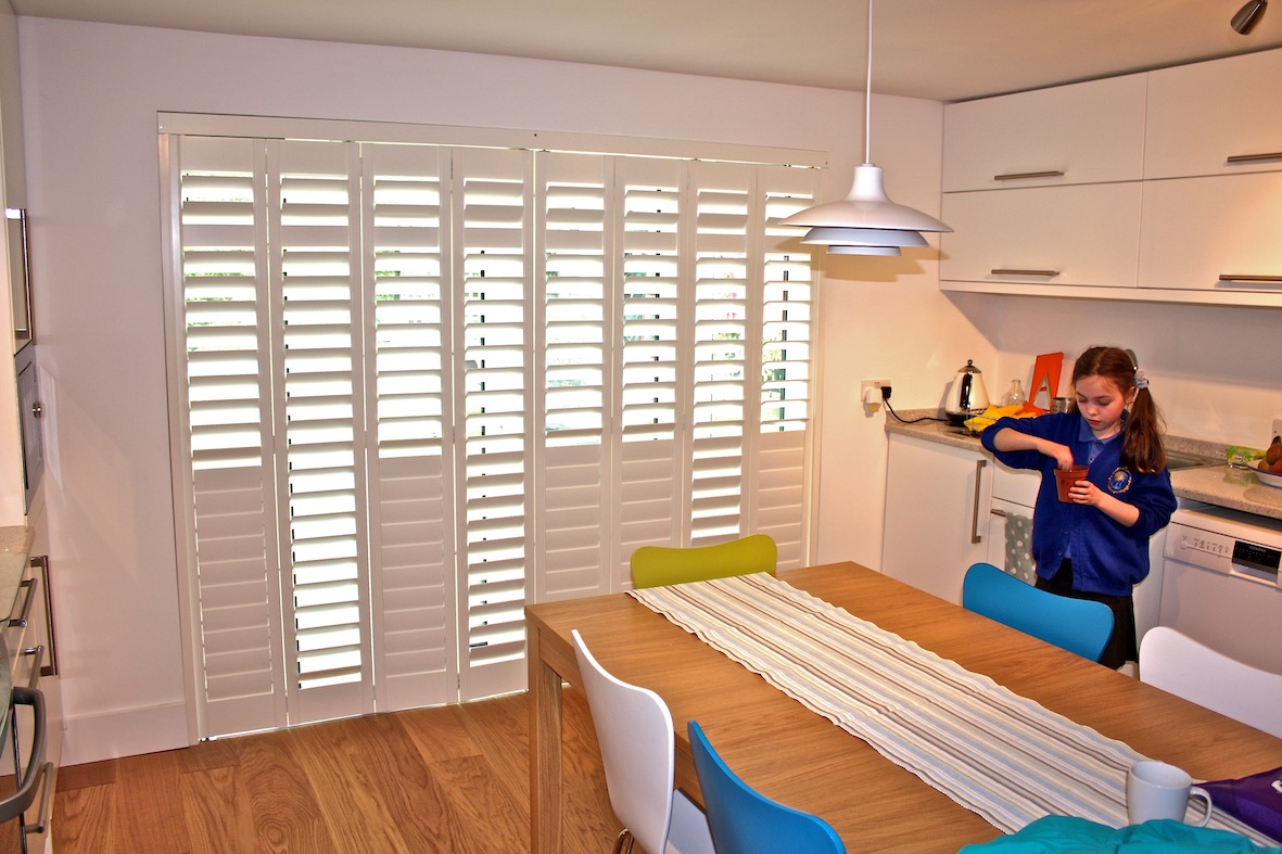Tracked Shutters In A Kitchen Door
