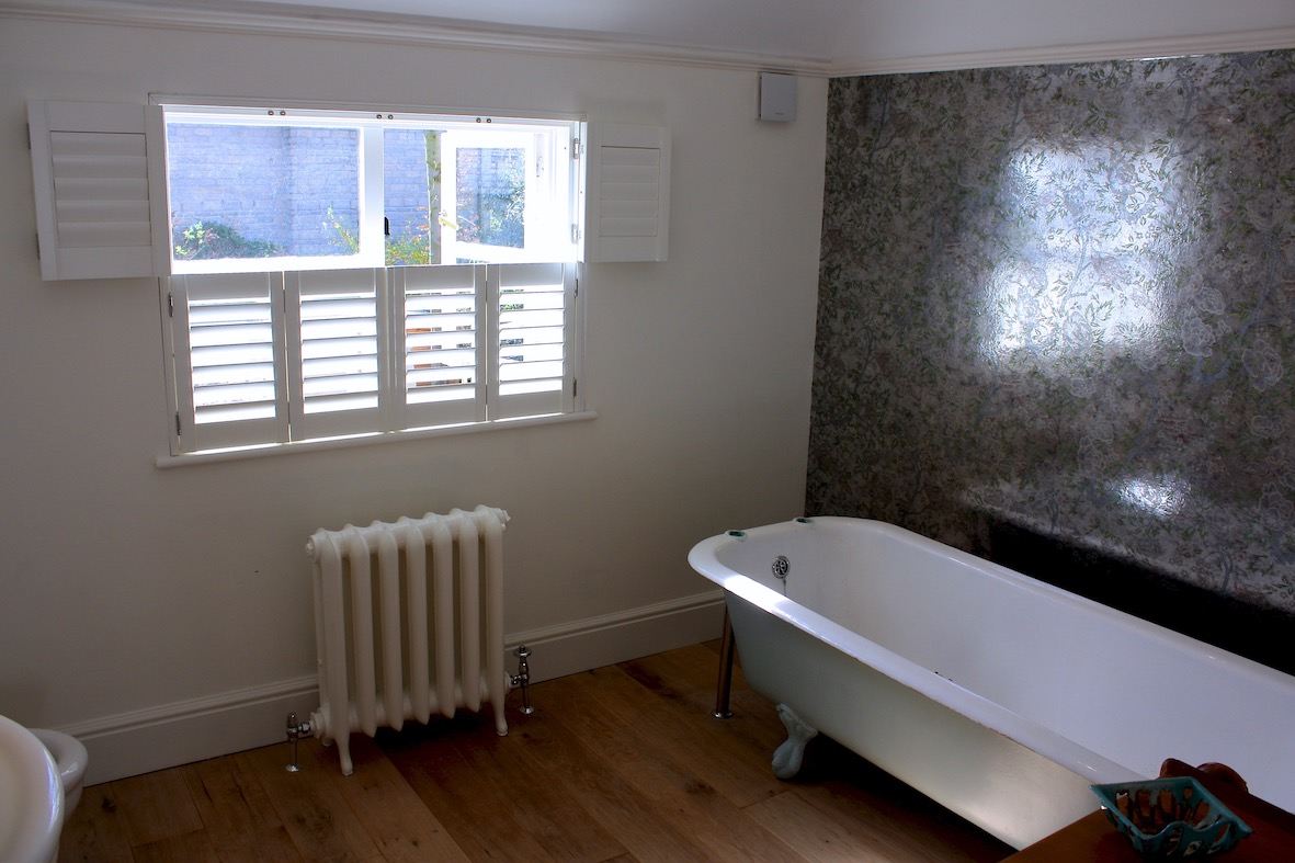 Tier On Tier Shutters In A Bathroom Top Folding back
