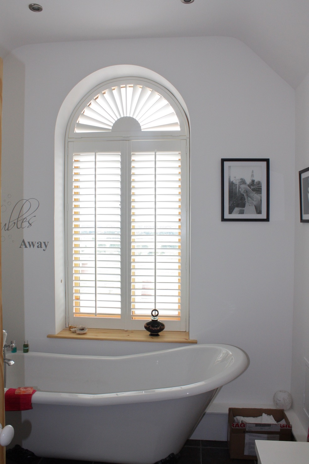 Curved Top Plantation Shutter In Bathroom