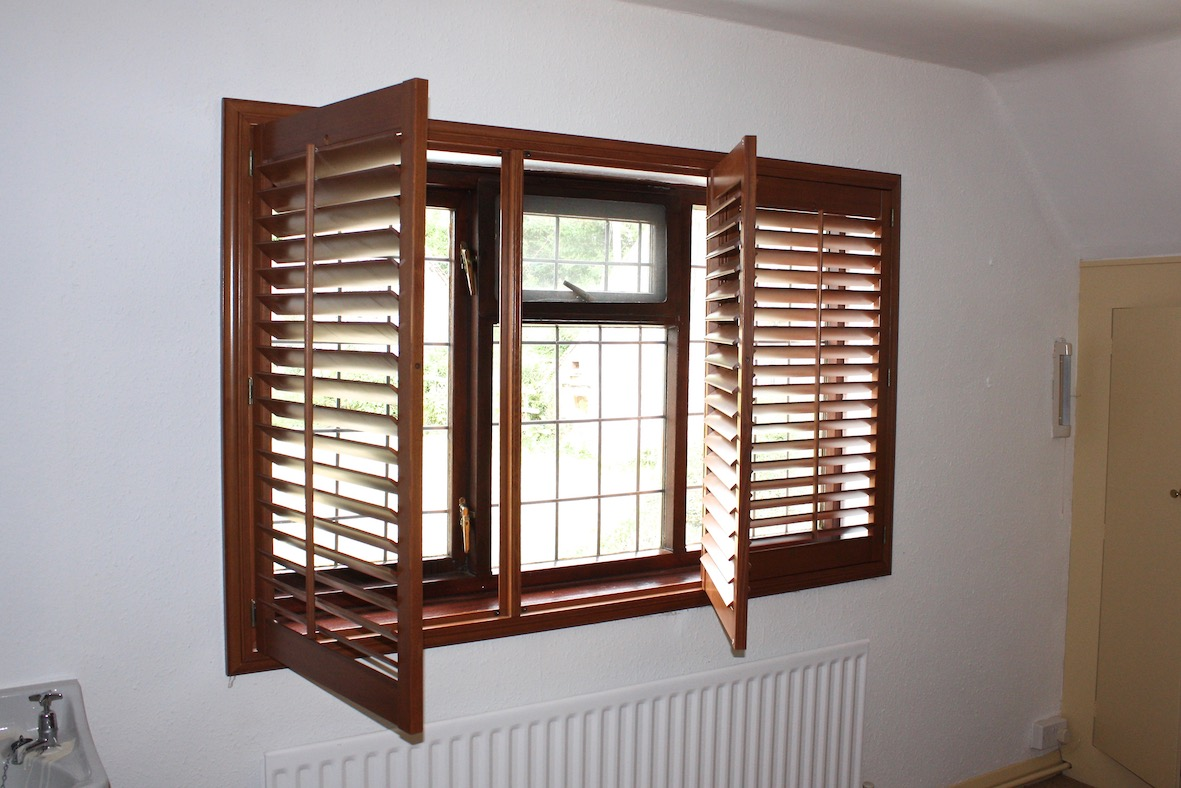 Staimed triple panel hardwood stained shutter