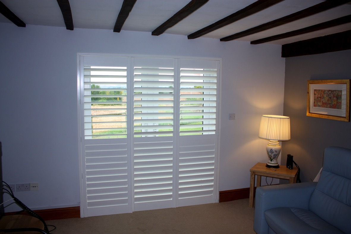 Three large  Plantation Shutters In A Converted Barn Doorway