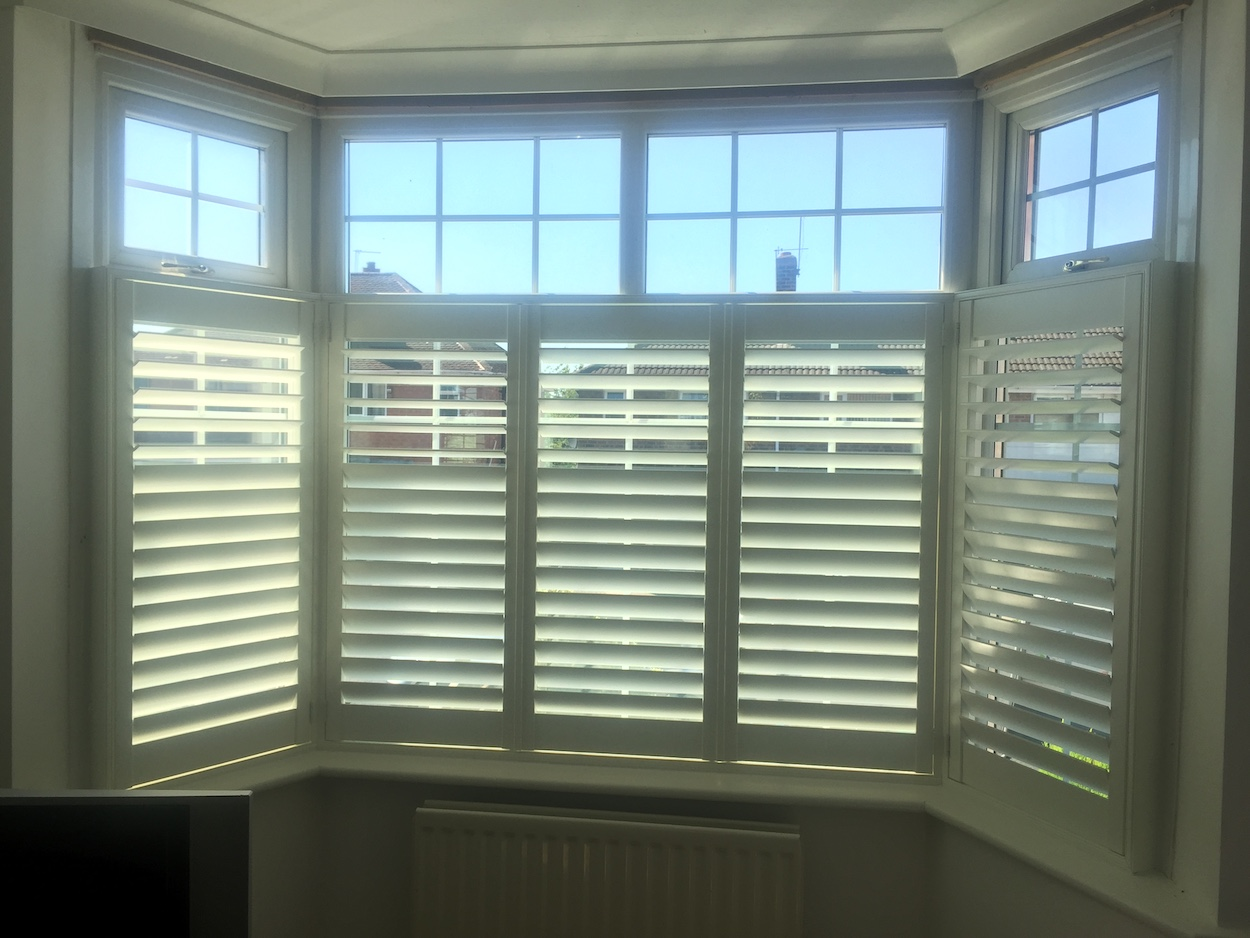 Partial Height Shutters In A Bay Window