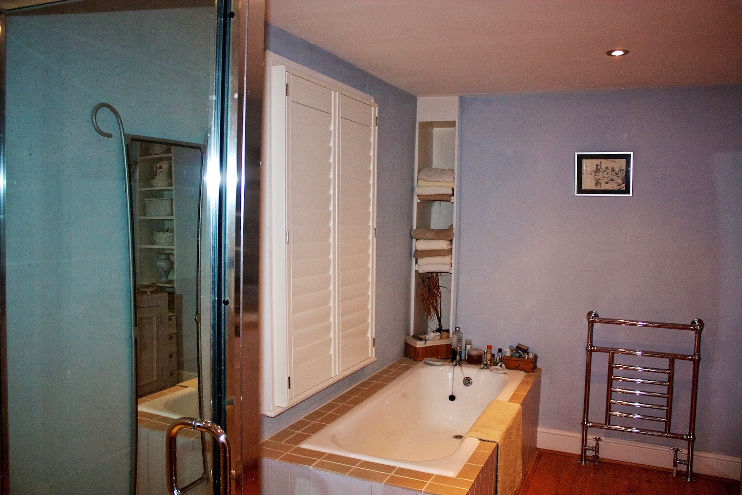 Plantation Shutters Above A Bath