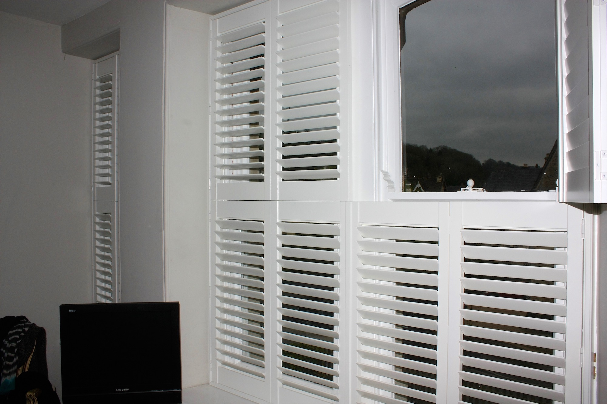 2 Tier On Tier Shutter Sets in Same Room