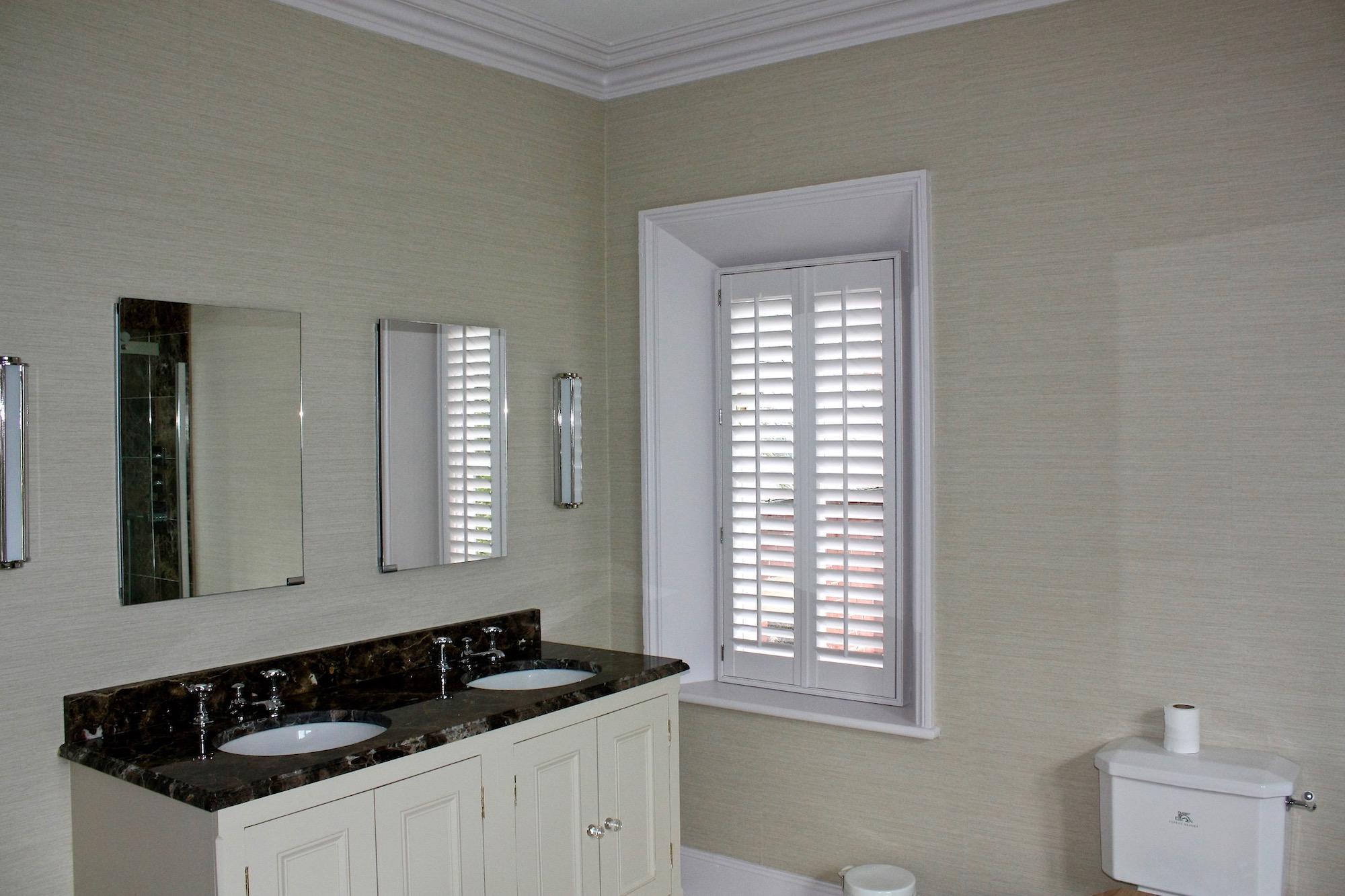 Tall  Plantation Shutters In A Minimal Bathroom