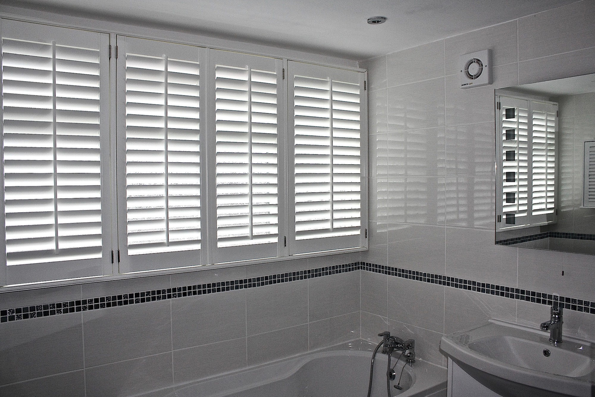 Two  Plantation Shutters Above a Bath