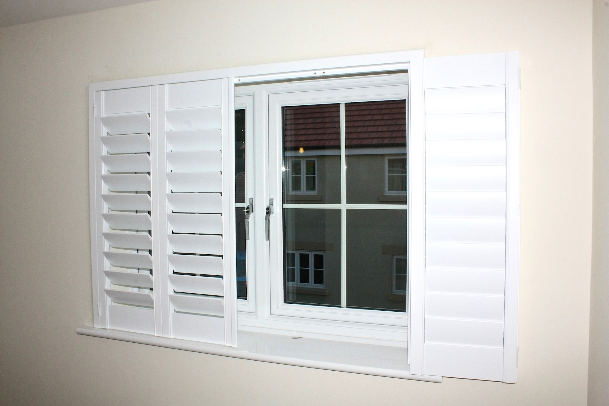 Bifolding Shutters With Blackout Blind In A Bedroom