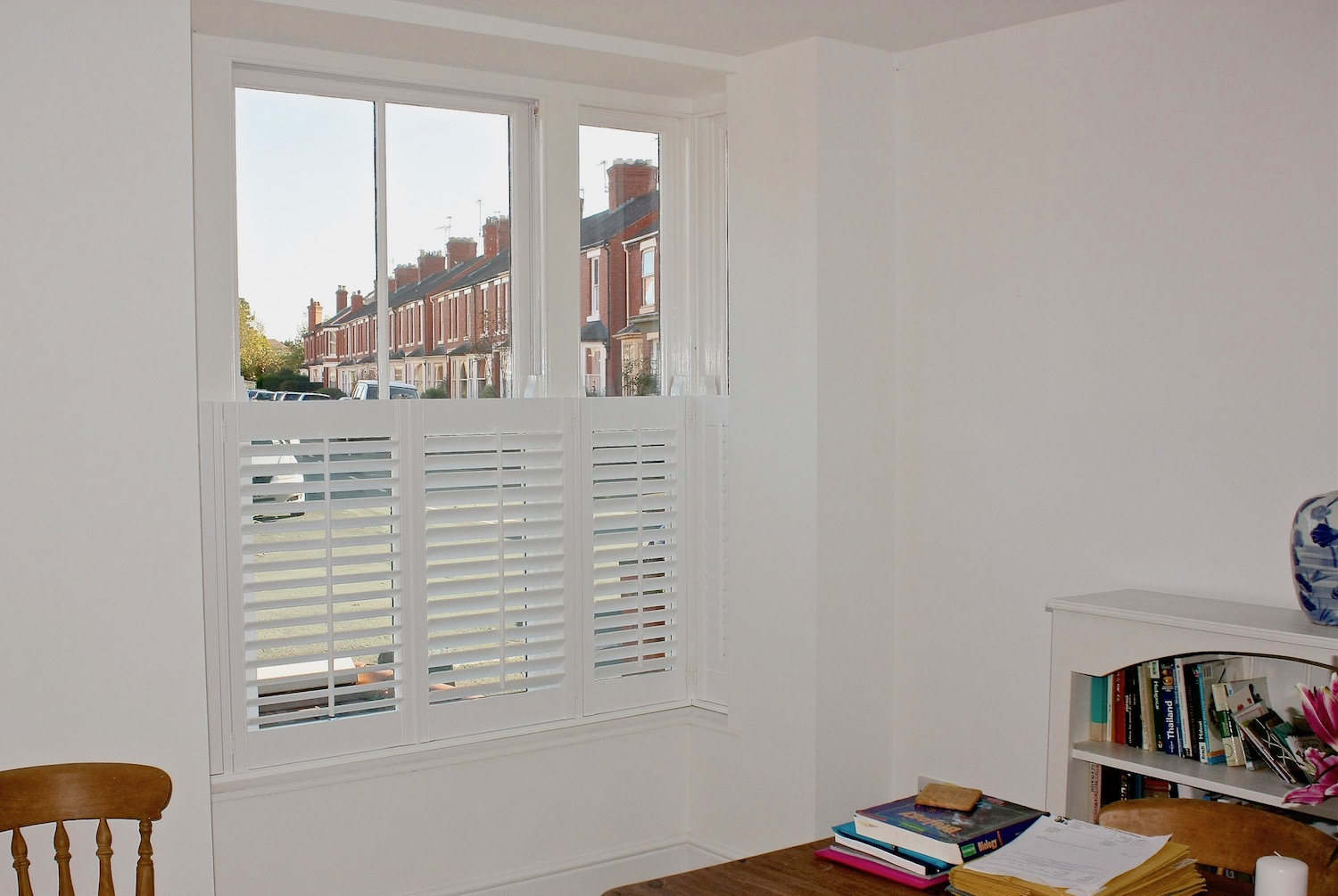Cafe Style Shutter In a Square Bay Widow