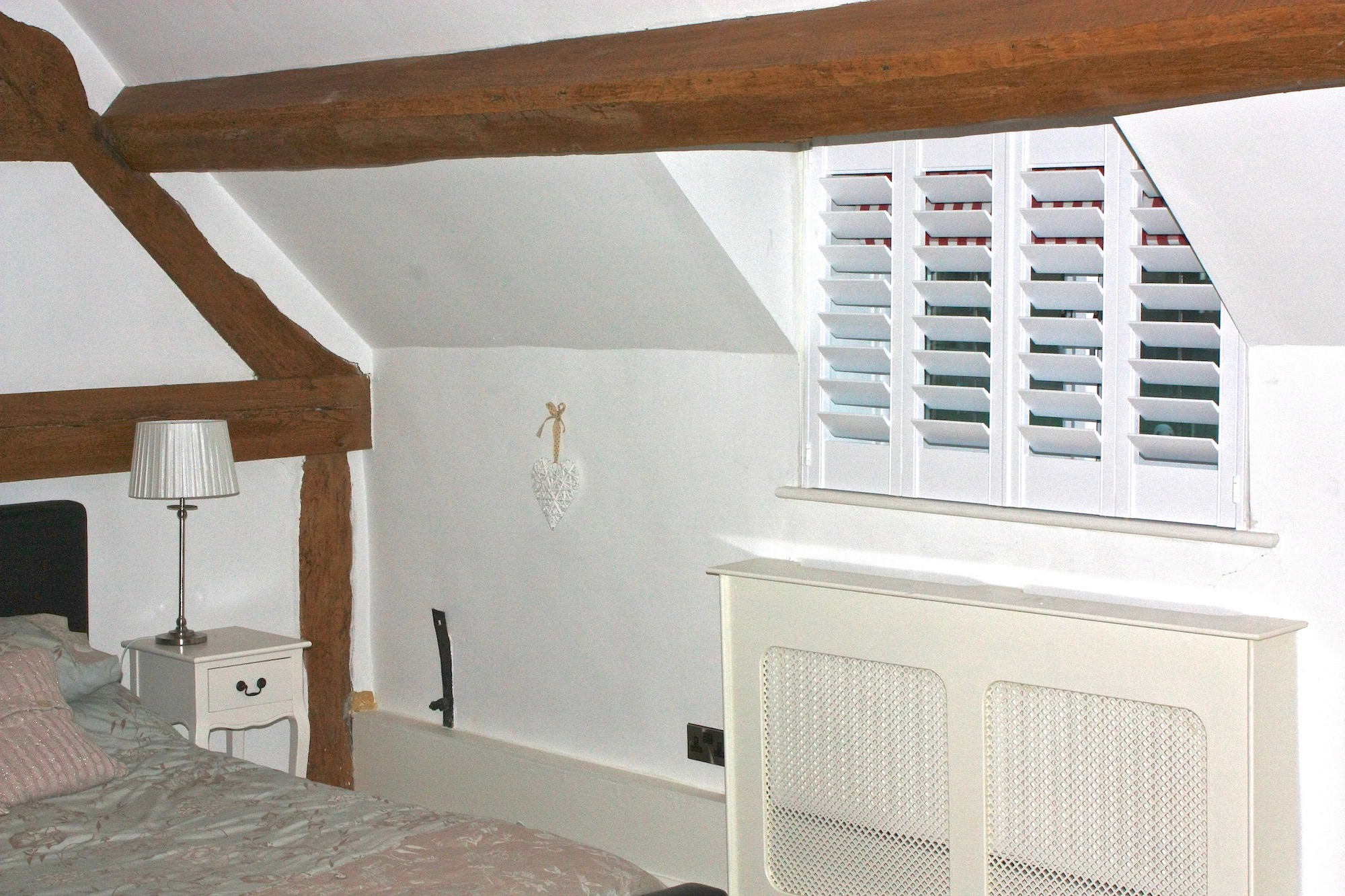 Beams and Shutters In An Ancient Timber Frame House