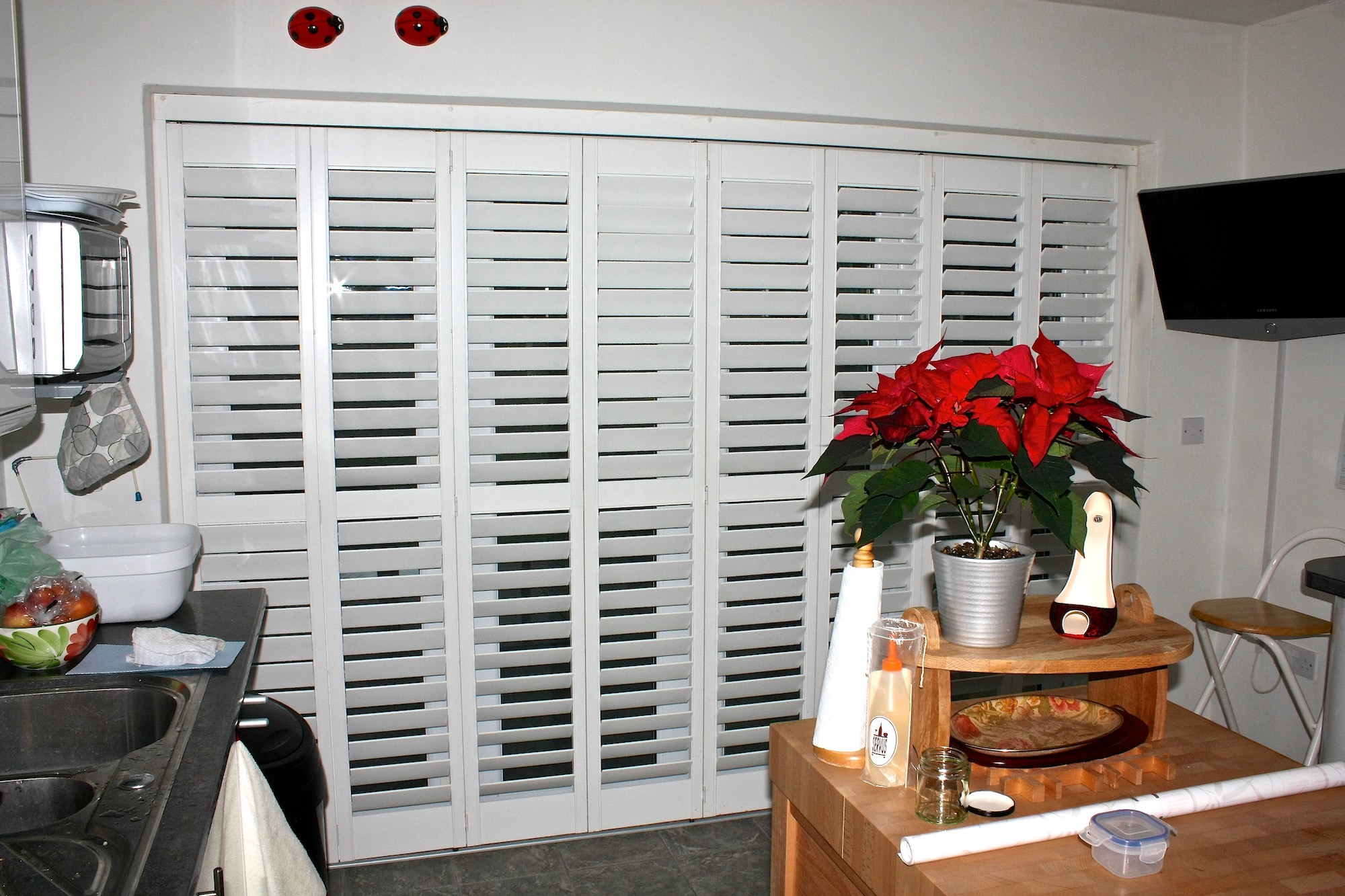 Tracked shutters in a kitchen