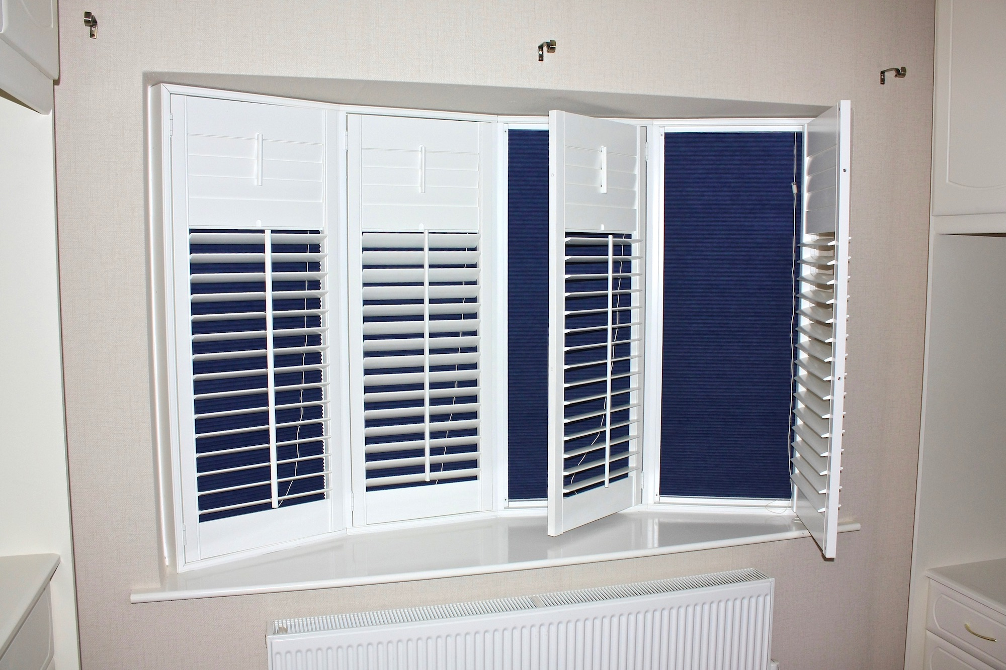 Small Bow Window With  Plantation Shutters Including Blckout Blinds