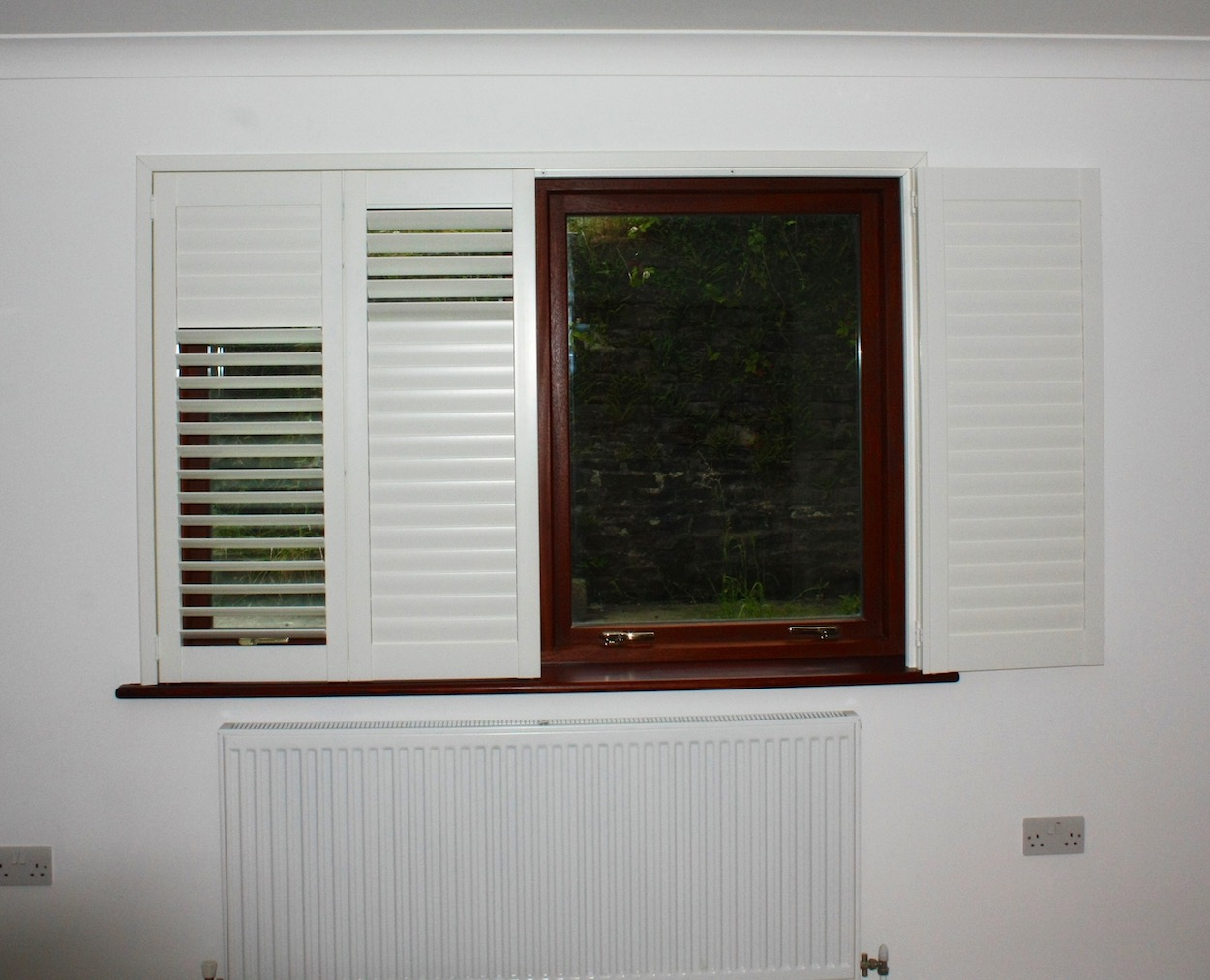 Large Bifolding Shutters Folding Back To The Wall