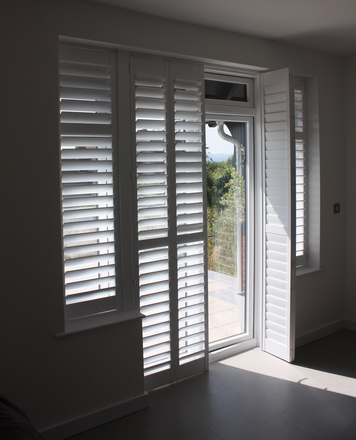 Frech Type Doors With Wing Windows Dresse With  Plantation Shutters