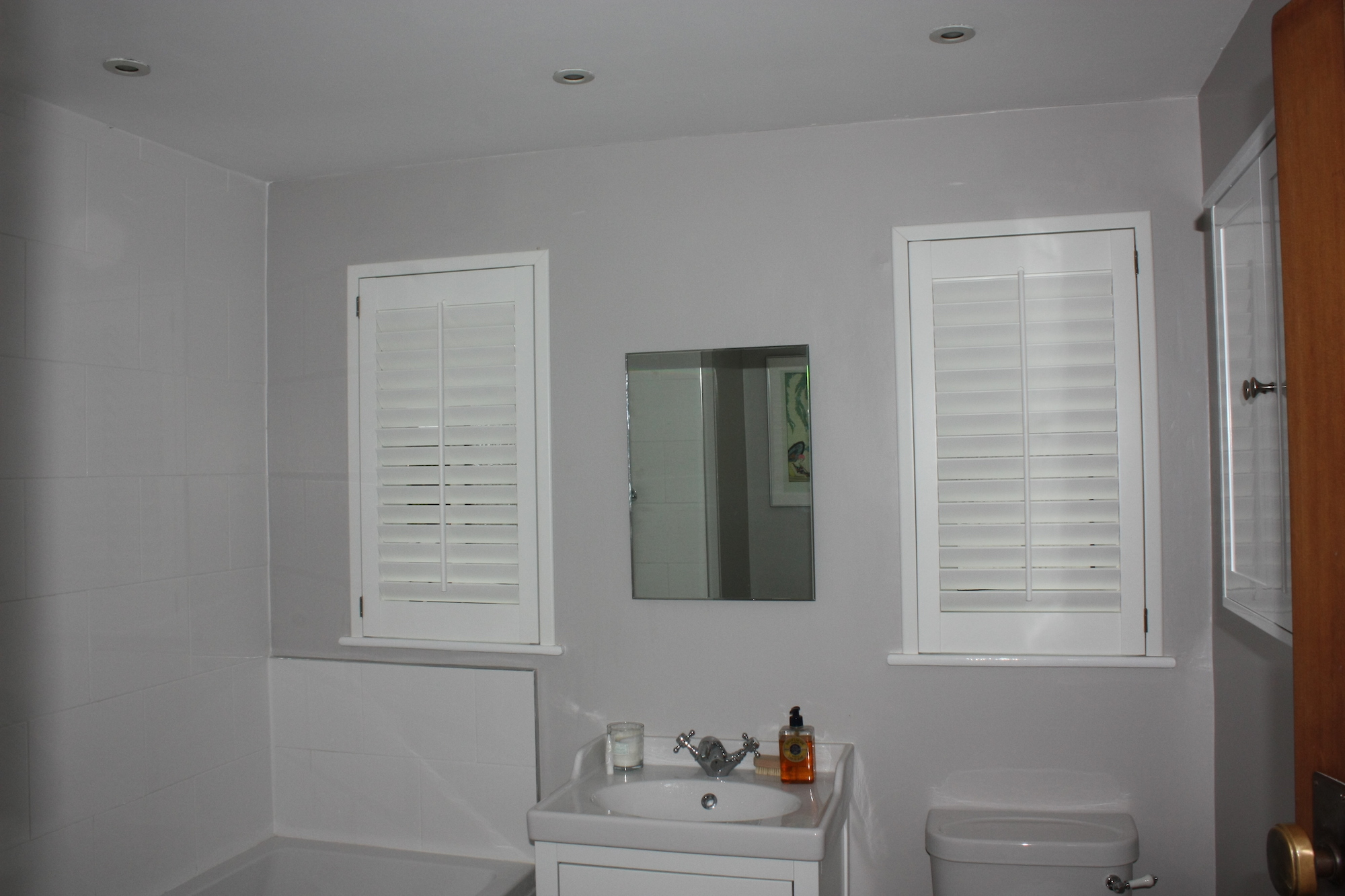 Twin  Plantation Shutters In A Bathroom