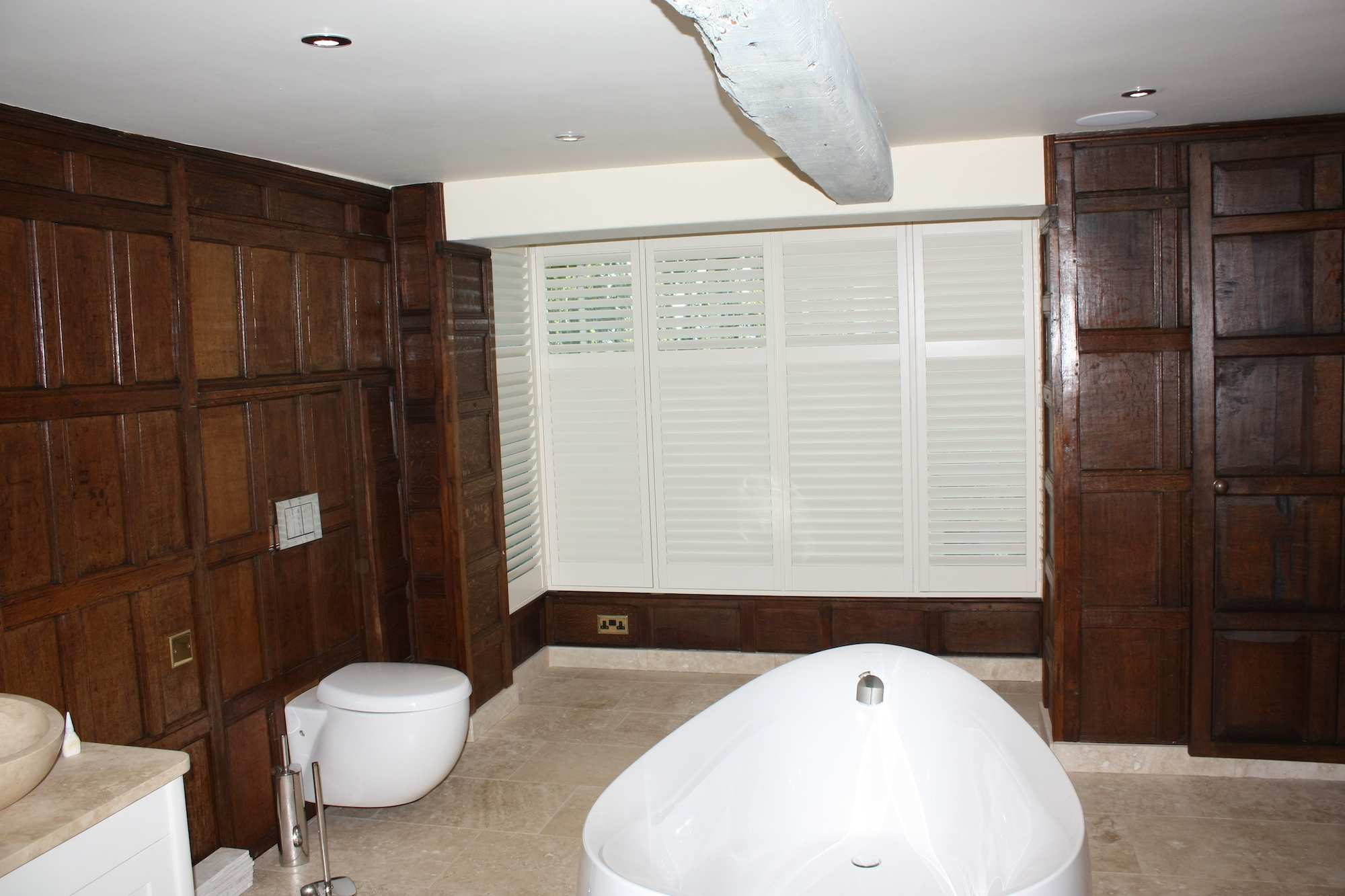 Oak Paneled Ultra Modern Bathroom With Bay Window And  Plantation Shutters